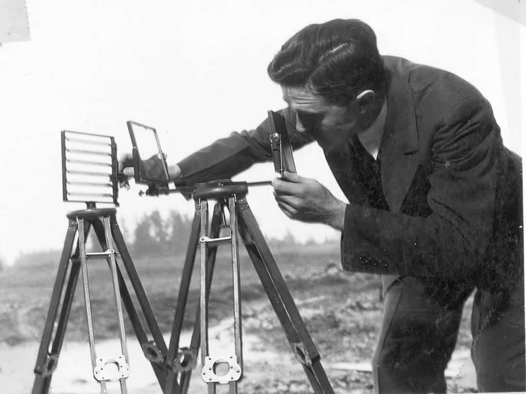 Harold Lawson from the Portland Radio Laboratory operates a heliograph, c. 1936. Heliographs were used by the Forest Service to send messages using sunlight reflected in flashes from a mirror.