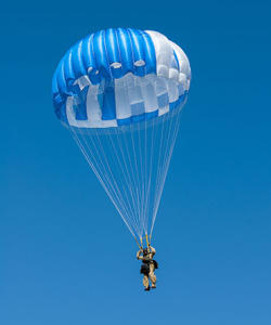 A smokejumper tests a FS-14 parachute at the Technology and Development Center in Missoula, Montana. (USFS)
